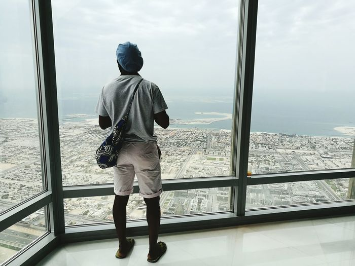 Looking At View Looking Through Window Cloud - Sky Vacations People Day Sky City Sea Dubai Burj Kalifa Flying High