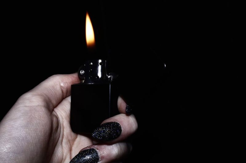 Close-up of hand holding candle