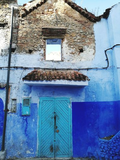 blue wall blue door at chefchaoune, Morocco Morocco Africa Chefchaoune Blue Blue City Soonjourney MyWanderLust Blue Whitewashed Water Door Window Close-up Architecture Building Exterior Built Structure Entrance Closed Door Front Door Locked Entryway Gate