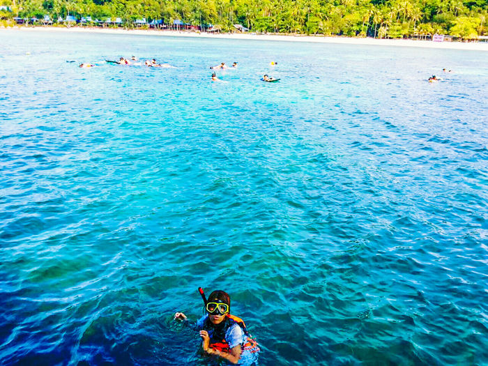 Beautiful sea Water Leisure Activity Sea Real People Swimming Lifestyles Blue Waterfront Day One Person Nature Men Beauty In Nature Trip Vacations Holiday Sport Incidental People Snorkeling Outdoors Turquoise Colored Swimming Pool