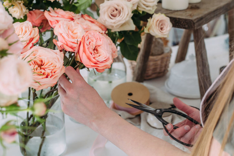 Close-up of hand holding rose bouquet