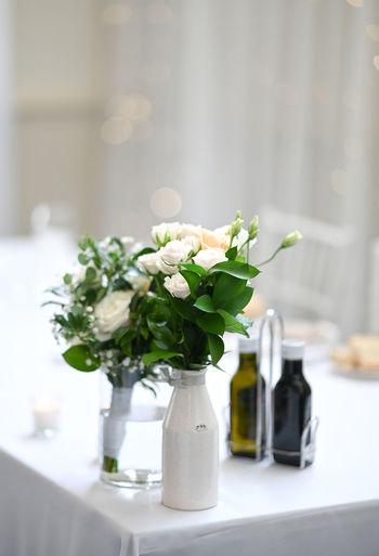 White flower vase on table