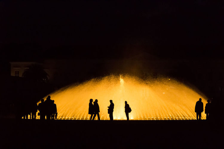 I night out at the illuminated fountains of Hannover. Fountain Germany Illuminated Illumination Night Outdoors People Real People Silhouette Sky