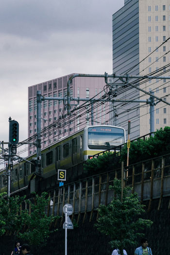 Architecture Building Building Exterior Built Structure City Day Mode Of Transportation Modern Nature No People Office Building Exterior Outdoors Plant Public Transportation Rail Transportation Sign Sky Train Train - Vehicle Transportation Tree EyeEmNewHere