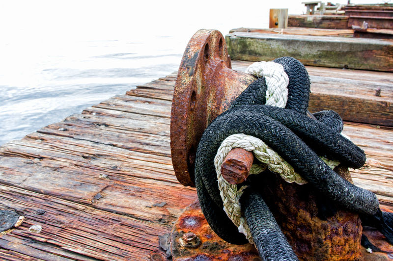 Close-up of rope on pier