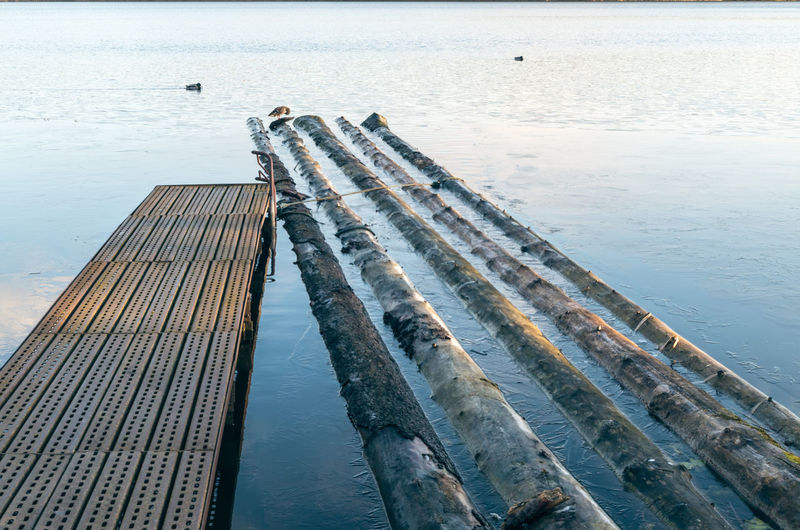 High angle view of pier over lake against sky