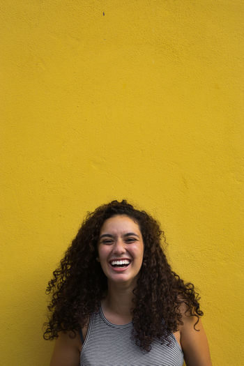 Only Women Smiling Yellow Happiness Curly Hair Laughing Portrait Outdoors Young Women Looking At Camera
