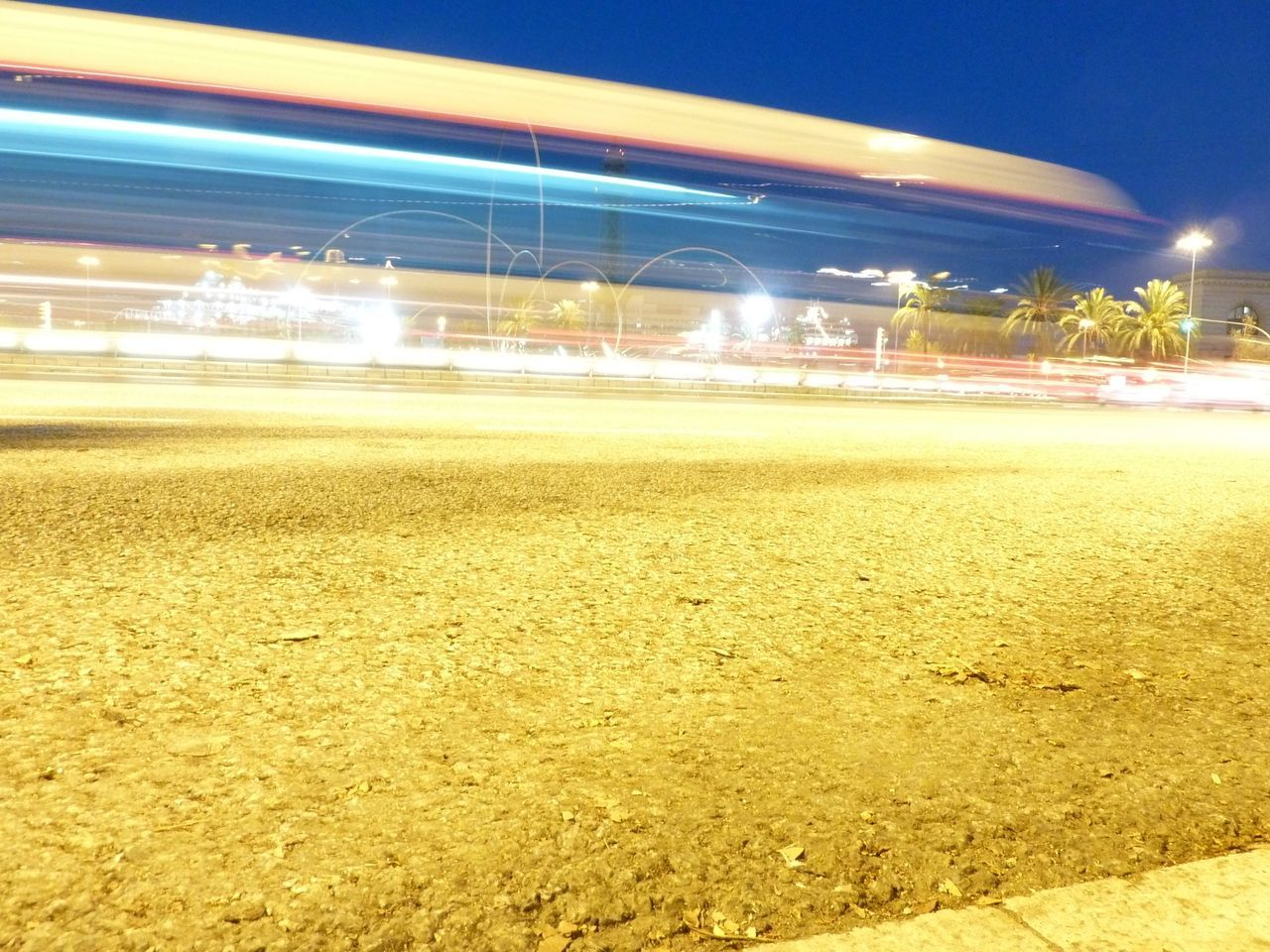 night, illuminated, speed, long exposure, motion, light trail, no people, transportation, blurred motion, outdoors, sky, road, yellow, built structure, city, architecture, clear sky, nature