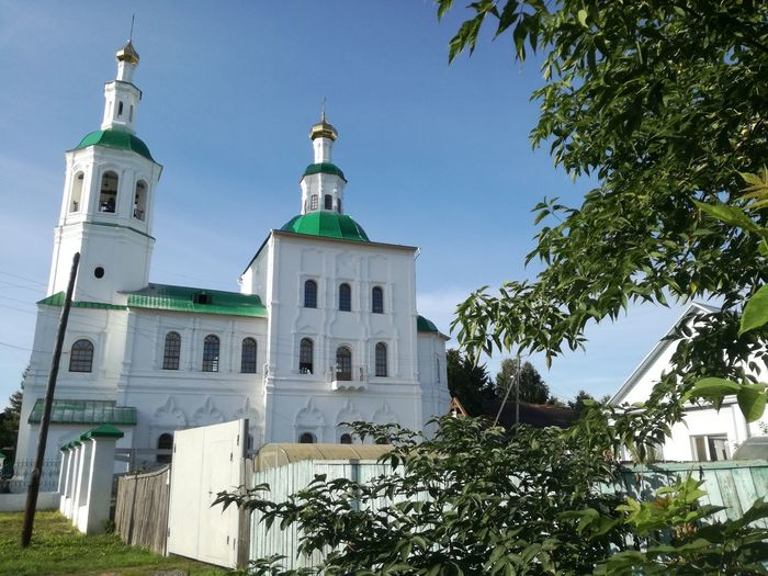 Architecture History Building Exterior No People Low Angle View Tree Sky Day Built Structure Outdoors Clear Sky White Green Nature Omsk Region Summertime Church