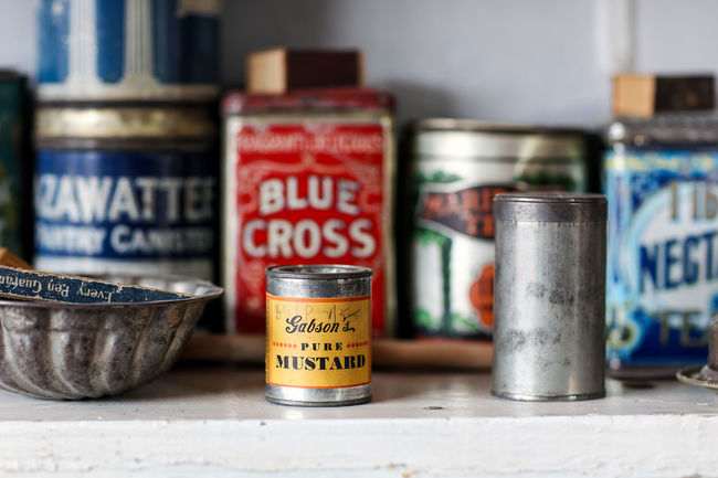 In Helen Martins' kitchen Blue Cross Close-up Containers Helen Martins Indoors  Kitchen Kitchen Life Kitchen Shelves Neiu Bethesda No People Owl House Pantry Pantry Shelves South Africa Tins