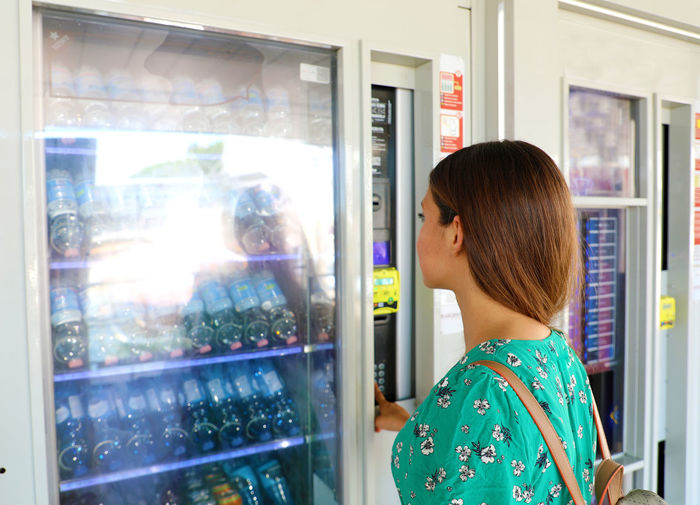 Woman looking at drink display in store