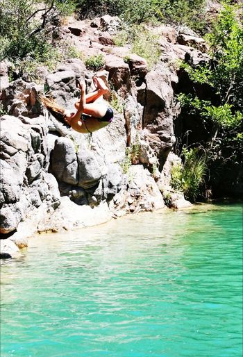 Fossil Creek, AZ Diving Water Summer Relaxation Leisure Activity Vacations Real People Outdoors Nature Lifestyles Young Women Young Adult Swimming One Person Day Fun Beauty In Nature