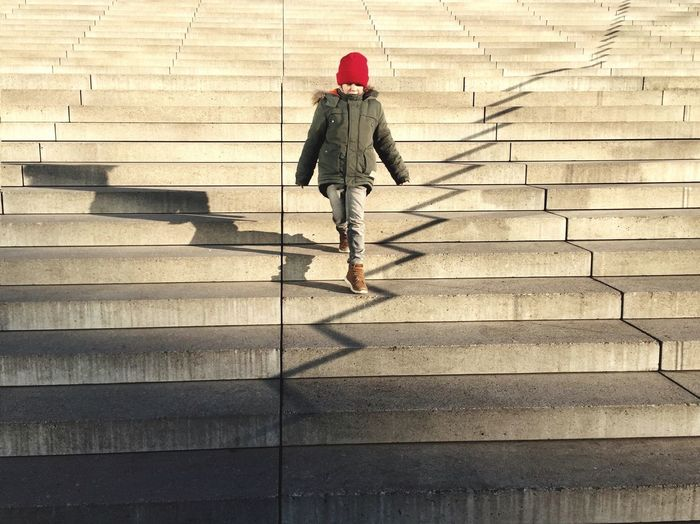 Rear view of woman walking on stairs