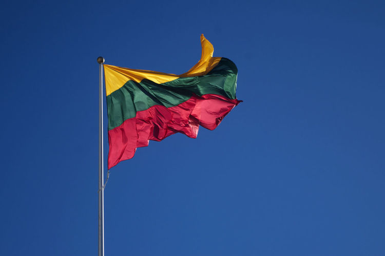 Low Angle View Of Lithunian Flag Against Clear Blue Sky
