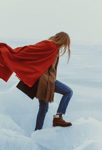 EyeEmNewHere Beauty In Nature Casual Clothing Cold Temperature Energetic Full Length Leisure Activity Lifestyles Motion Nature One Person Outdoors People Real People Red Snow Standing Winter Young Adult Young Women Fresh on Market 2017 Fashion Stories Shades Of Winter
