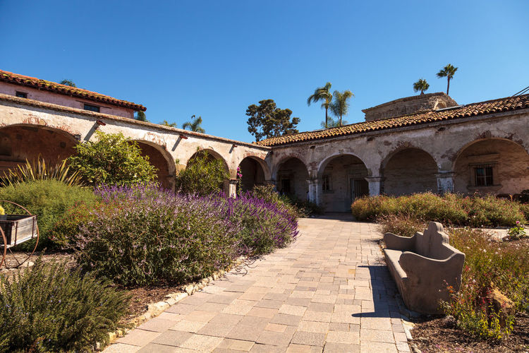 San Juan Capistrano, CA, USA —September 25, 2016: The Mission San Juan Capistrano in Southern California, United States. Editorial use only. Bells California Church Day Garden Landmark Mission Mission San Juan Capistrano Outdoors Religious  Ruins San Juan Capistrano Statue Tranquility United States