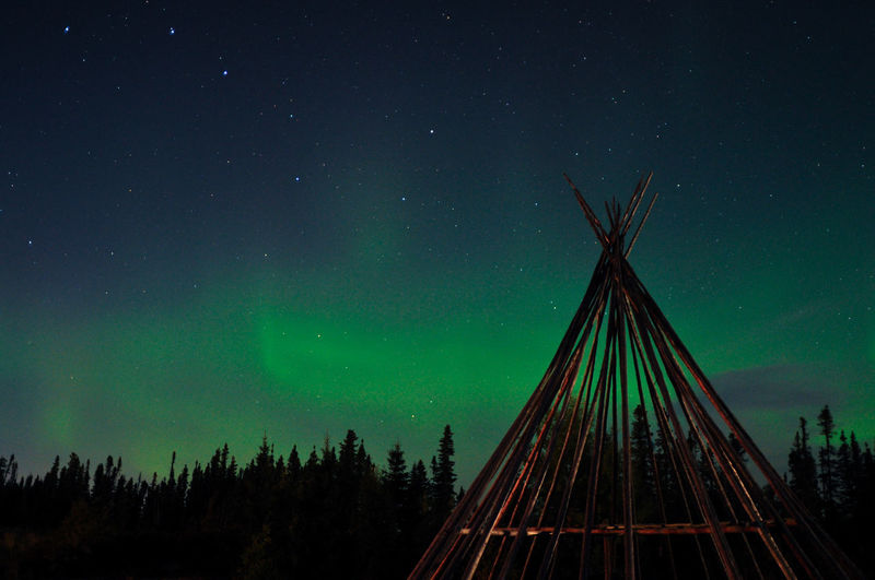 Northern lights above a teepee in quebec