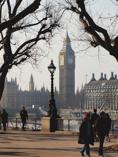 People on street while big ben in background