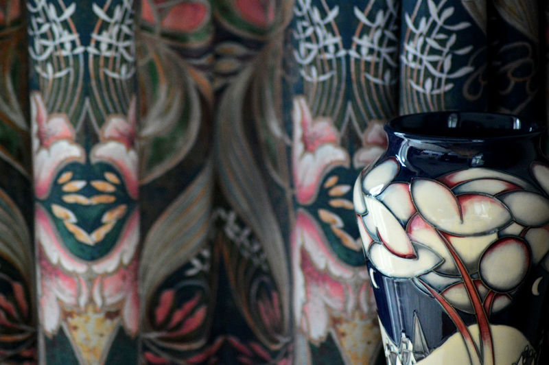 Close-up of painted vase for sale at market stall