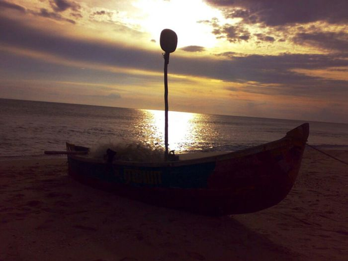 Sunset with fishing boat on beach India Outdoors Nature Landscape Travel Colours Sunset Lights & Shadows Travel Destinations Beach