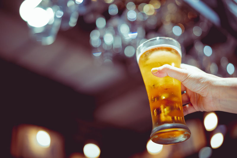 Refreshment Drink Hand Alcohol Food And Drink Glass Beer Dark Bottoms Up Celebration Bar Lager Bokeh
