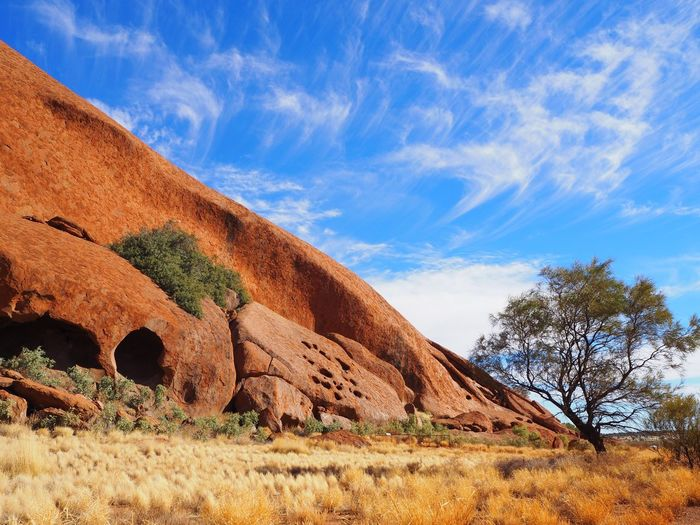 Central Australia (incl. Larapinta Trail) Beauty In Nature Blue Cloud - Sky Day Environment Grass Land Landscape Mountain Nature No People Non-urban Scene Outdoors Plant Rock Scenics - Nature Semi-arid Sky Tranquil Scene Tranquility Tree