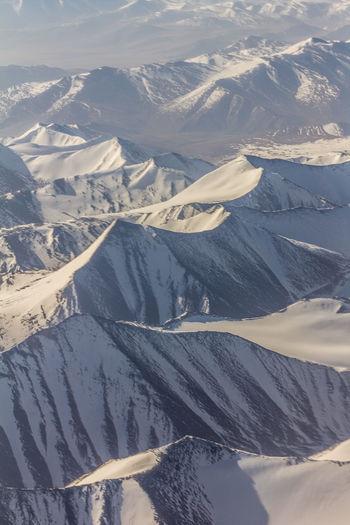 Himalayan Mountains in Ladakh Kashmir Leh Leh Ladakh.. Himalayas Mountain Snow Winter Cold Temperature Landscape Scenics - Nature Environment Beauty In Nature Snowcapped Mountain Nature Tranquility Tranquil Scene No People Mountain Range Day Non-urban Scene Travel Idyllic High Angle View Range Mountain Peak Location