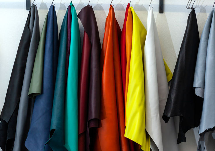 Close-up of multi colored clothes hanging on rack in store