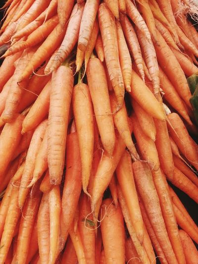 Orange color Food And Drink Orange Color Backgrounds Market Food Retail  Market Stall No People Healthy Eating Freshness Outdoors Nature Close-up Day Carrot Carrots Carrot Greens