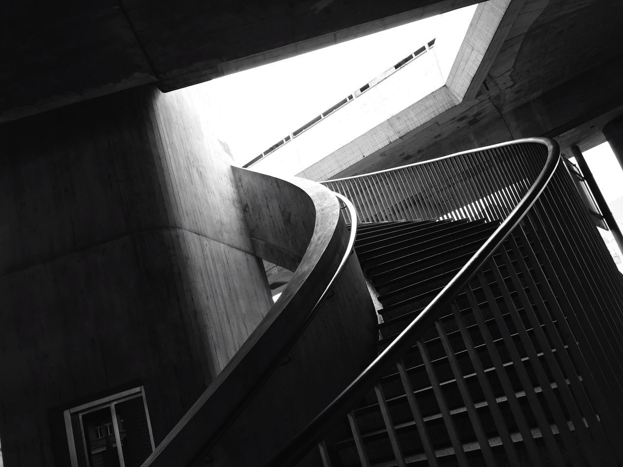 Low Angle View Of Staircase By Bridge