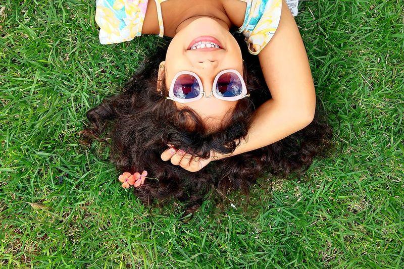 High angle view of woman lying down on grass