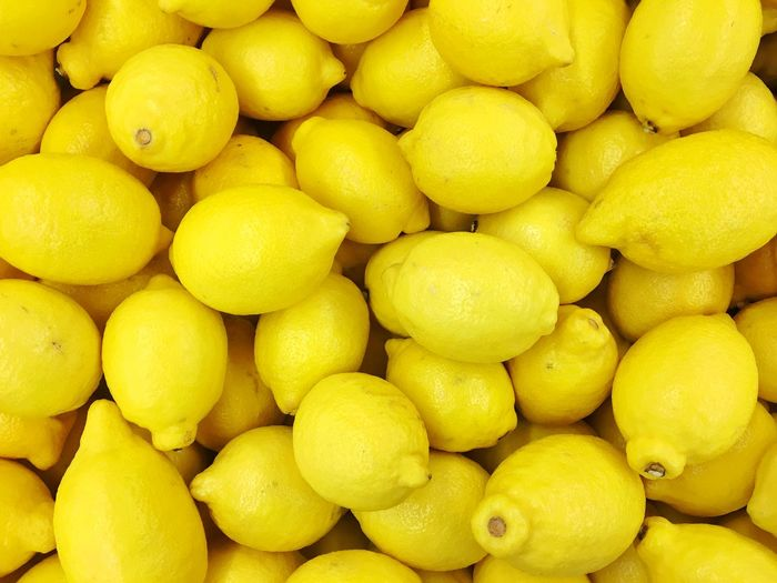 Full Frame Food And Drink Healthy Eating Food Freshness Backgrounds Large Group Of Objects Abundance For Sale Fruit Wellbeing Retail  Yellow Market Citrus Fruit No People Close-up Heap Still Life Lemon