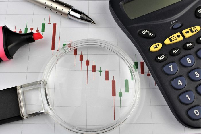 An image of a business concept Bank Banker Business Chart Financial Figures Graph Money Neon Number Pen Stockexchange