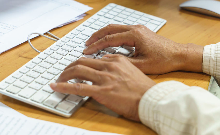 hand typing keyboard computer. Body Part Business Communication Computer Computer Equipment Computer Key Computer Keyboard Computer Part Connection Desk Finger Hand Human Body Part Human Hand Indoors  Keyboard Laptop One Person Surfing The Net Table Technology Typing Using Computer Using Laptop Wireless Technology