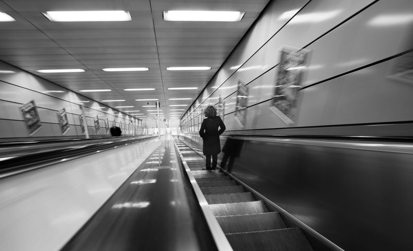 Adult Adults Only Airport Architecture Built Structure Connection Convenience Day Escalator Futuristic Illuminated Indoors  Modern Motion Moving Stairway Moving Walkway  One Person People Railing Real People Technology The Way Forward Transportation Travel