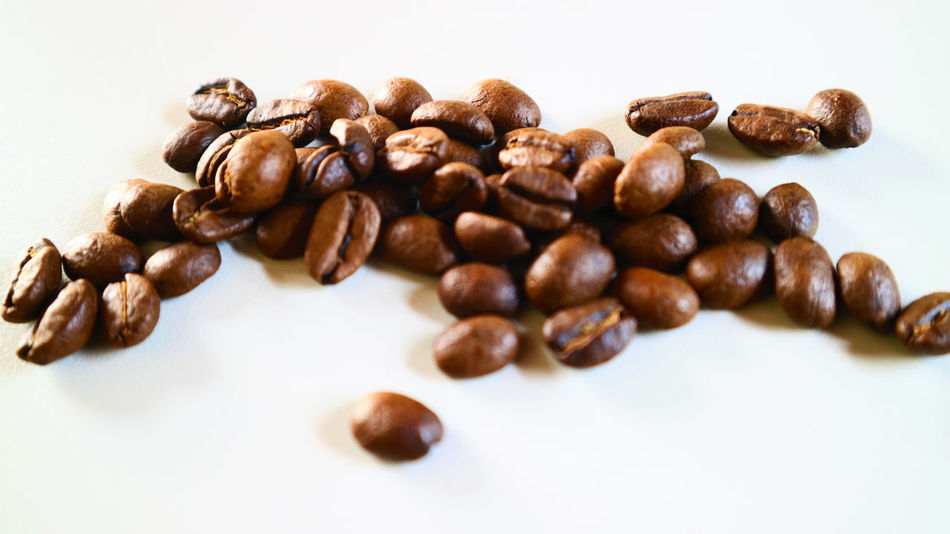 The Coffee Bean Brown Close-up Coffee - Drink Coffee Bean Coffee Cup Food Food And Drink Freshness Healthy Eating Indoors  Mocha No People Raw Coffee Bean Roasted Roasted Coffee Bean Scented Studio Shot White Background