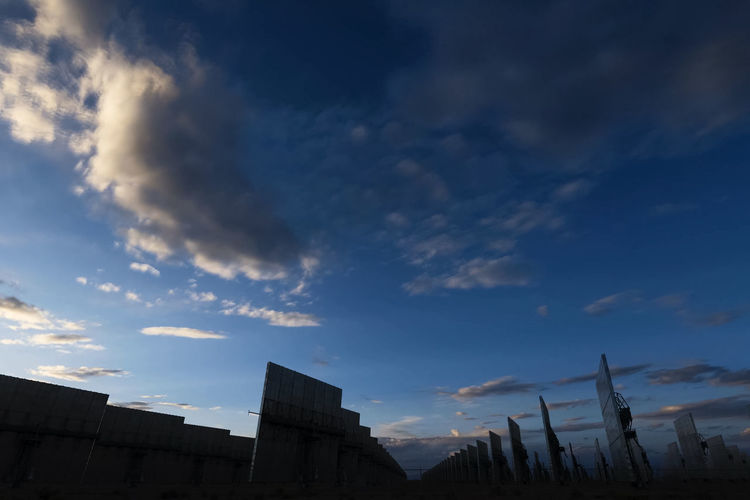 solar panels Sky Cloud - Sky Architecture Building Exterior Built Structure Nature Low Angle View No People Building Sunset Outdoors City Beauty In Nature Silhouette High Section Scenics - Nature Industry Day Blue Sunlight Solar Panels
