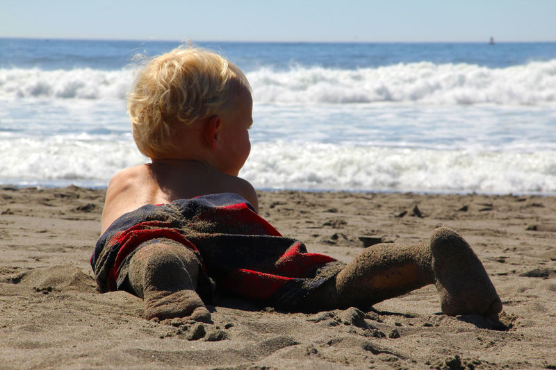 Beach Beach Life Blonde Hair Boy Childhood Full Length Horizon Over Water Leisure Activity Lifestyles Nature Pacific Northwest  Pacific Ocean Person Relax Relaxation Sand Sandy Sea Shore Sitting Sky Tranquility Vacations Water Wave