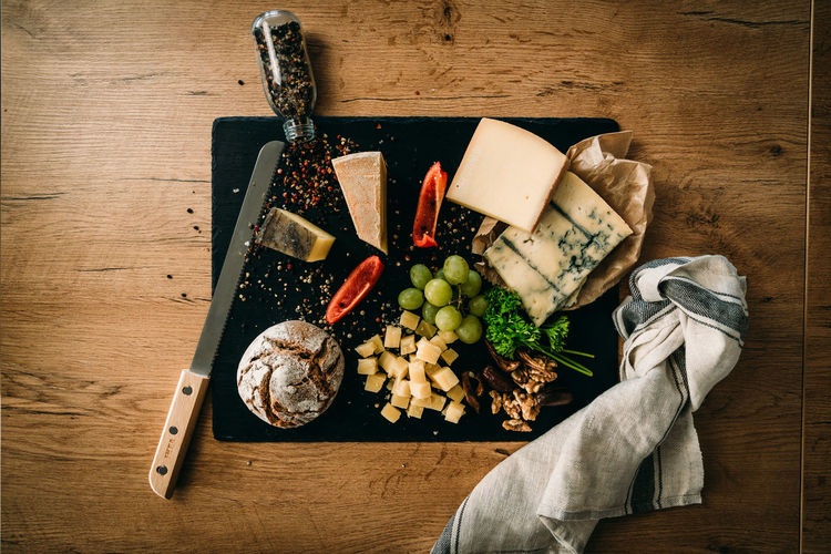 Food Food And Drink Wood - Material Directly Above High Angle View Wellbeing Variation Cheese Vegetable French Food Cutting Board Healthy Eating Fruit Preparation  Bread Breakfast Knife Nuts Pepper