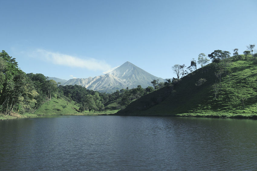 Volcan Santa Maria- Santiaguito Guatemala Beauty In Nature Day Idyllic Lake Landscape Mountain Mountain Range Nature No People Outdoors Peak Quetzaltenango Scenics Sky Tranquil Scene Tranquility Tree Volcanic Landscape Volcano Water Waterfront An Eye For Travel Go Higher This Is Latin America