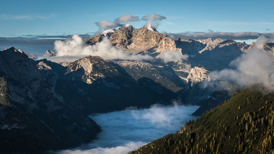 The three clouds Beauty In Nature Mountain Scenics - Nature Non-urban Scene Sky Tranquil Scene Mountain Range Geology Nature No People Tranquility Power In Nature Day Physical Geography Environment Landscape Idyllic Outdoors Mountain Peak Fog Mist Clouds Dolomites