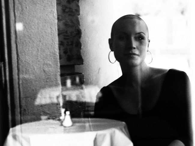 Alone Bald Bald Girl Baldhead Blackandwhite Cafe Cafeteria Day Food And Drink Lady Lifestyles Mysterious Mystery One Young Woman Only Real People Sad Sadness Shaved Hair Shaved Head Solitude Vintage Woman