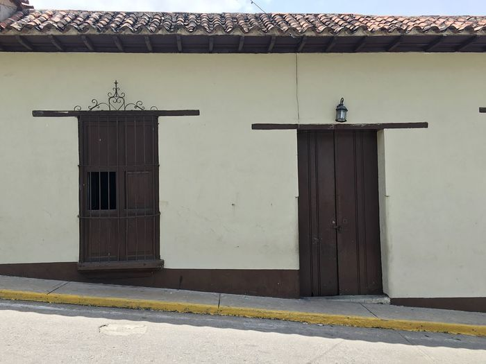 No People House Door Architecture Built Structure Building Exterior Outdoors Day Doorway Animal Themes Choroni Choroni_Vnzla Architecture Tiled Roof  Residential Building Town Architecture Colonial Style Colonial Architecture Caribbean Architecture Cloud - Sky Carribean Life