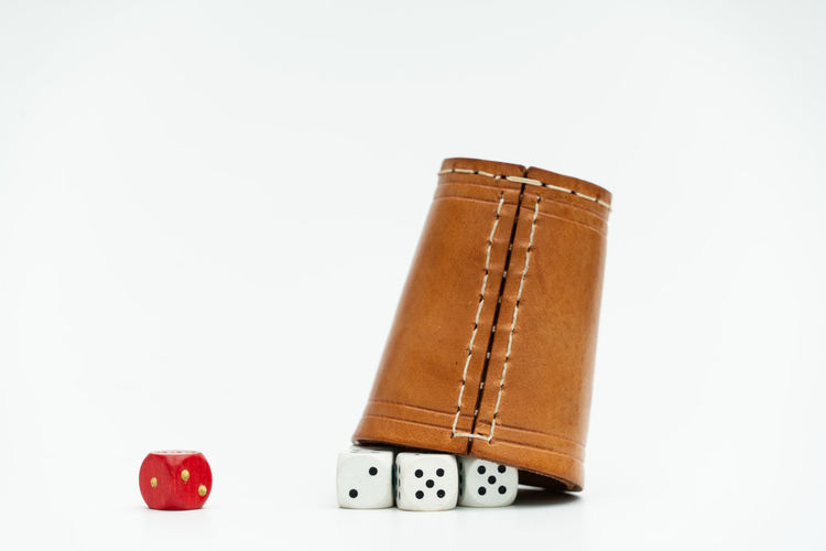 Diversity Studio Shot White Background Copy Space Indoors  No People Leather Cut Out Gambling Single Object Still Life Luck Close-up Opportunity Red Simplicity Antique Leisure Games Book Number
