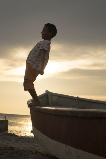 Beach Childhood Colombia Colombia ♥  Day EyeEm Best Shots EyeEmBestPics Fun Nature Nautical Vessel One Person Outdoors People Santa Marta, Colombia Sea Sky Standing Sun Sunset Water