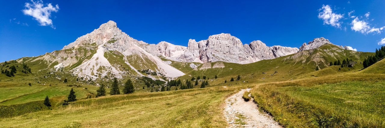 EyeEm Selects Mountain Landscape Mountain Range Nature Scenics Sky Outdoors Beauty In Nature Rural Scene Travel Destinations Vacations Panoramic Day No People Snow Tree Grass Dolomites, Italy Dolomites Clouds Clouds And Sky