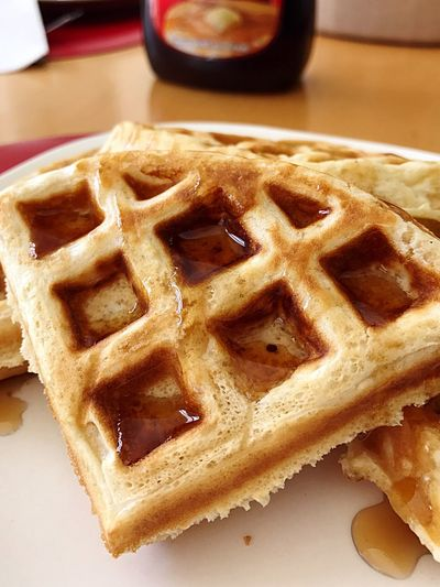Food And Drink Waffle waffles with maple syrup