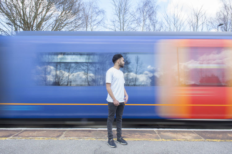 Casual Clothing Day Fast Full Length Leisure Activity Long Shot Man Motion Motion Blur Motion Capture Motionblur Outdoors Portrait Standing Still Train Train Station Tree