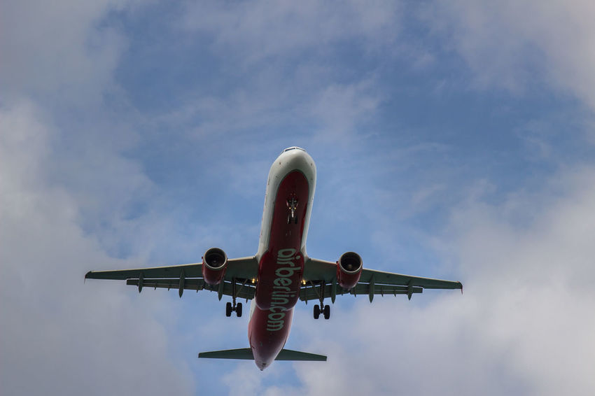 Aerospace Industry Air Berlin Air Vehicle Airplane Baleares Commercial Airplane Dramatic Sky Flying Landing - Touching Down Low Angle View Mallorca Mode Of Transport Tourism Tourism Destination Transportation Travel Vacations Let's Go. Together.