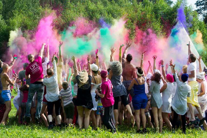Arms Raised Celebration Crowd Day Emotion Enjoyment Excitement Festival Fun Group Of People Hand Raised Holi Human Arm Large Group Of People Lifestyles Men Multi Colored Outdoors Playing Powder Paint Real People Togetherness Traditional Festival Women